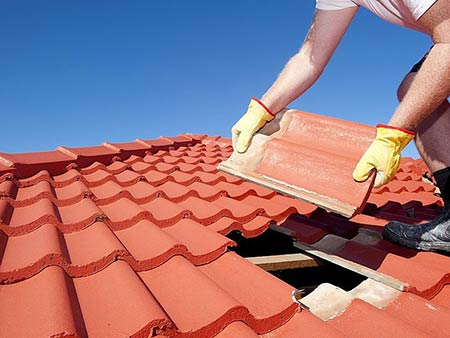 Woolton Roofing Specialists replacing roof tiles